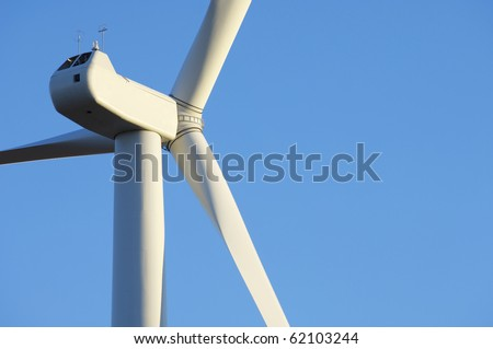 foreground of the top of a windmill for electricity production - stock photo