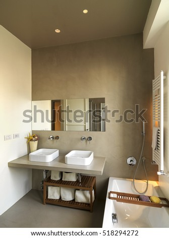 foreground of two counter top washbasin in a modern bathroom