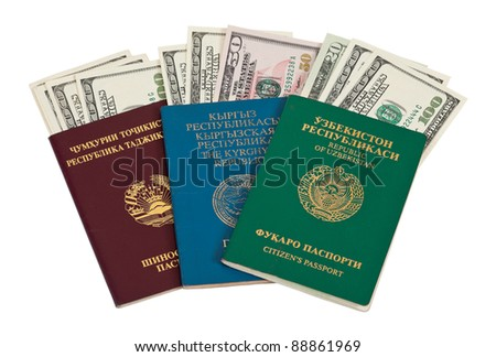 Foreign Passports and US dollars over white
