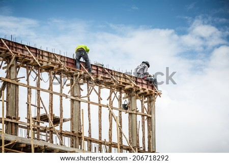 foreman and worker in construction site - stock photo