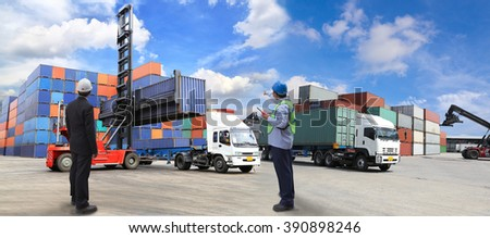 foreman control Industrial Container Cargo freight ship from his manager with working crane bridge in shipyard with truck - stock photo