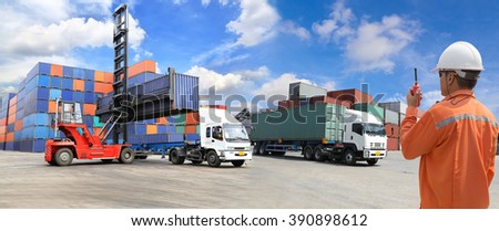 foreman control loading Containers box at shipyard - stock photo