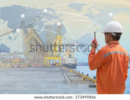foreman control loading Containers box from Cargo freight ship for Logistic Import Export background (Elements of this image furnished by NASA) - stock photo