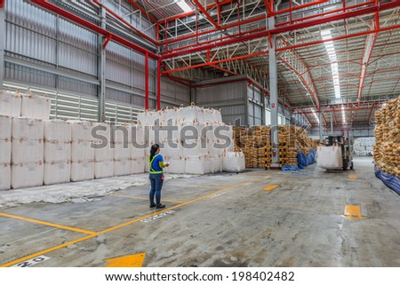 foreman control  the worker driving a forklift loader in warehouse with load jumbo bag - stock photo
