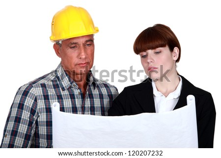 Foreman giving his opinion to architect - stock photo