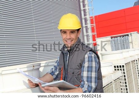 Foreman on industrial site with tablet