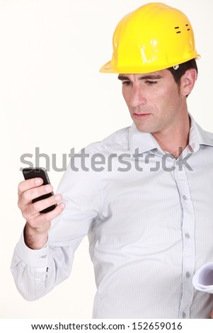 foreman reading sms - stock photo