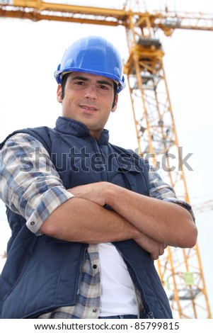 Foreman stood in-front of crane - stock photo