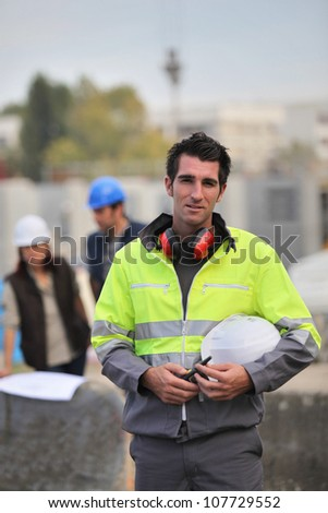Foreman surveying construction - stock photo