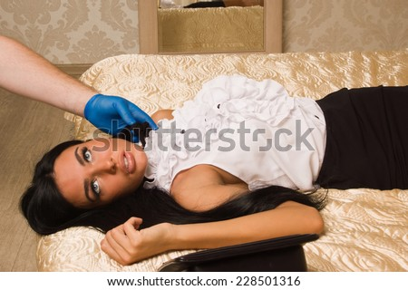 Forensic expert collecting evidence in a crime scene (imitation) - stock photo