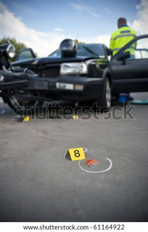 Forensics placard number 8 at an accident site, involving a motorcycle and a private vehicle next to a piece of broken glass in shallow Depth of Field - stock photo