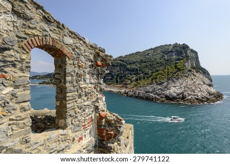 foreshortening of mediterranean island in La Spezia gulf with a stone window of St.Peter church in foreground, shot on a sunny spring day, Portovenere, Italy - stock photo