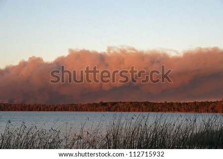 forest fire smoke plume - stock photo