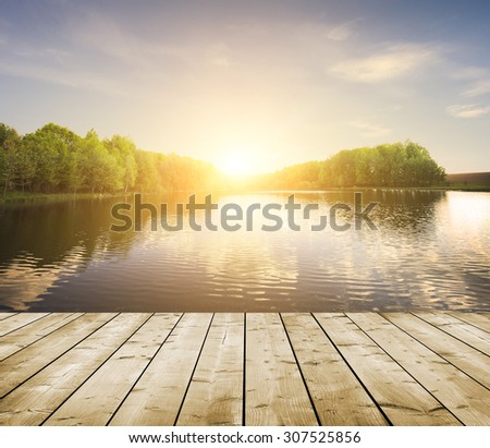 forest lake and wooden board background - stock photo