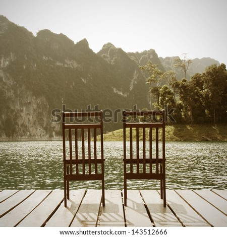 Forest lake and wooden board background Vintage concept - stock photo