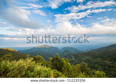 Forest mountain and blue sky - stock photo