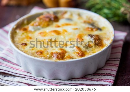 Forest mushrooms gratin , white, orange brown cap boletus with cream, cheese, French dish julienne - stock photo