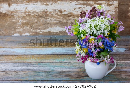 forest spring flowers on an old wooden surface, vintage style and rustic concept. Free space for text. Copy space.