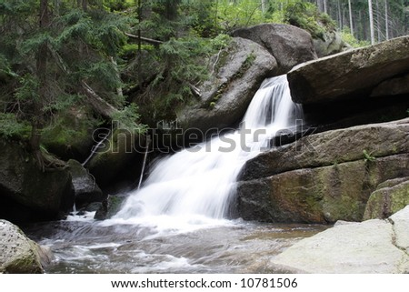 Forest waterfall on mountains river - stock photo