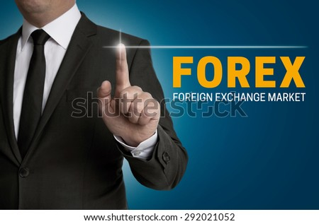Forex touchscreen is operated by businessman. - stock photo