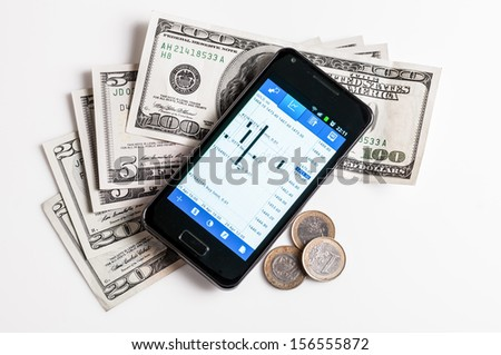 forex trading by mobile phone and money on white background - stock photo