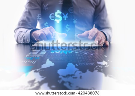 Forex trading concept. Businessman using futuristic tablet computer, pressing button on the touch screen and selecting icon dollar, euro, yen icons. - stock photo