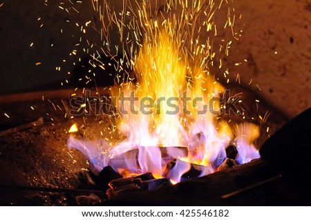 Forge fire Forge fire used for creating iron tools in blacksmith's. - stock photo