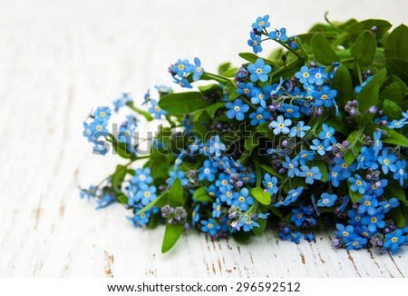 Forget me nots flowers  on a wooden background