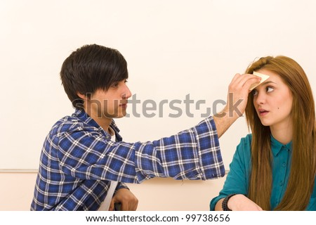 Forgetful girl getting a humorous reminder - stock photo