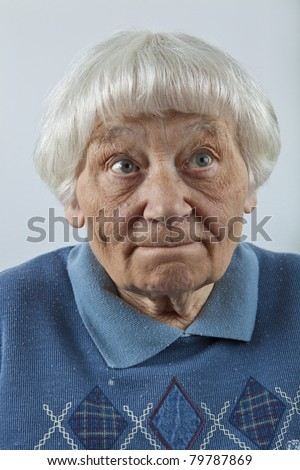 Forgetful senior woman head and shoulders portrait