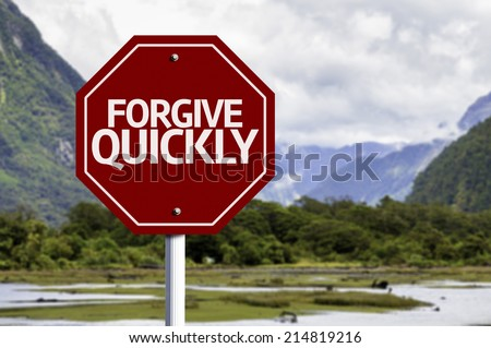 Forgive Quickly red sign with a landscape background - stock photo