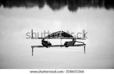 Forgotten wooden boat in the lake Kerkini in Greece  - stock photo