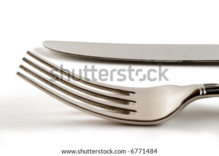 Fork and knife in white background - stock photo