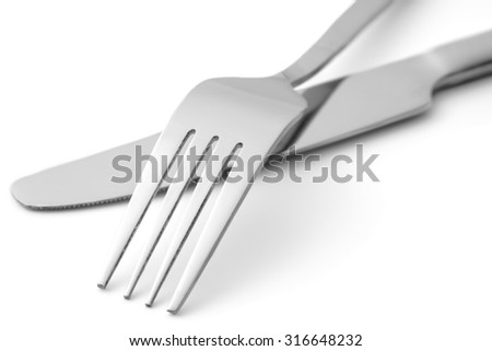 Fork and knife on white background close-up isolated - stock photo