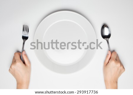 fork and spoon and empty plate - stock photo