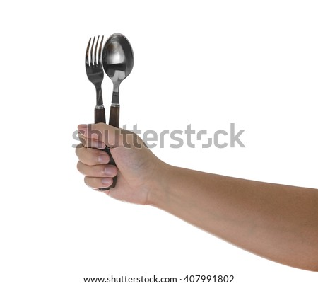Fork and spoon held by a man's hands isolated over white background - stock photo