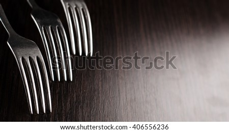 fork and spoon on a black background