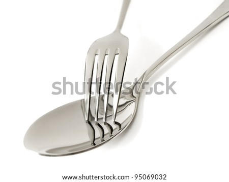 Fork and spoon on white background - stock photo