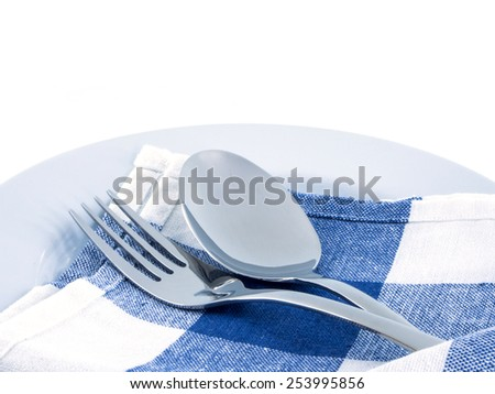 fork and spoon with serviette isolated on the white background