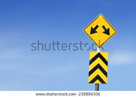 Fork in the road sign on sky background. - stock photo