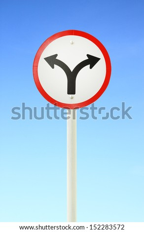 fork junction traffic sign with blue sky - stock photo