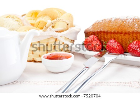 Fork, knife, strawberries, raspberries, slices of bread, sugar cubes and jam for healthy breakfast. Shallow DOF