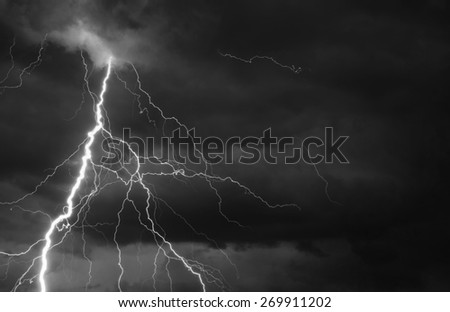 Fork lightning striking down during summer storm. - stock photo