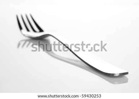 Fork on grey background - stock photo
