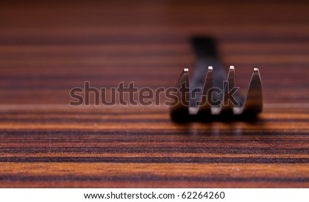 Fork's teeth up close - stock photo