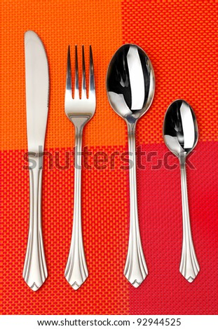 Fork, spoon and knife in a red cloth