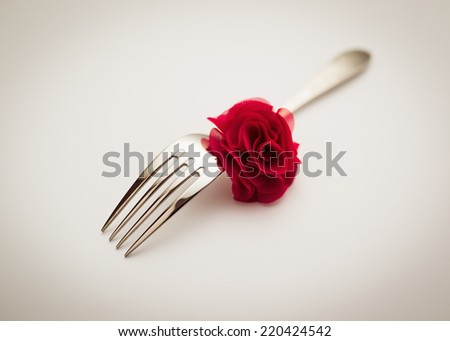Fork with decorative rose - stock photo