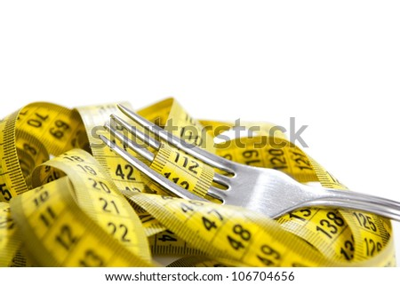 Fork with measuring tape isolated - stock photo