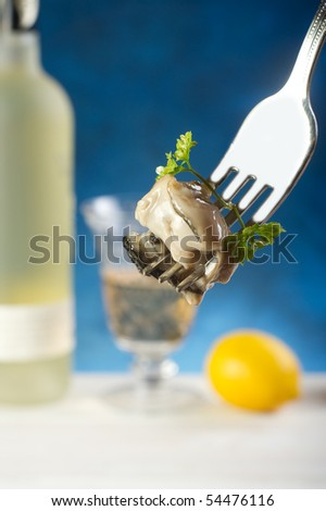 fork with oyster - stock photo