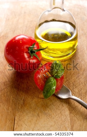 fork with slice tomato
